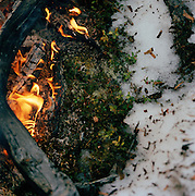 A small campfire in the snow in Lapland, Sweden