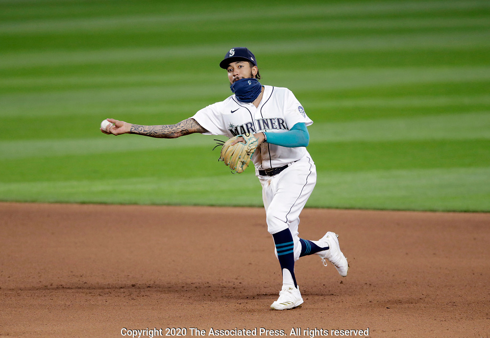 Seattle Mariners shortstop J.P. Crawford makes a throw after fielding a ground ball against the Texas Rangers during a baseball game, Saturday, Aug. 22, 2020, in Seattle. (AP Photo/John Froschauer)
