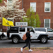 Hundreds of a vehicles gridlock downtown Annapolis, Maryland, April 18th, 2020, in protest of the stay at home order and closing of non-essential businesses by Maryland Governor Larry Hogan. Organizers are urging the governor to reopen businesses, churches and schools, saying there are other ways to social distance without shutting down the economy. <br /> <br /> - Photo By Perry Aston