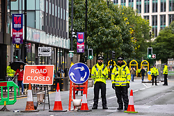 © Licensed to London News Pictures . 02/10/2021. Manchester, UK. Police stand guard and security barriers are erected around a secure zone , consisting of the Midland Hotel and Manchester Central Convention Centre , on the eve of the Conservative Party Conference . The Conservative Party Conference takes place at the Manchester Central Exhibition Centre from tomorrow (3rd October 2021). Photo credit: Joel Goodman/LNP