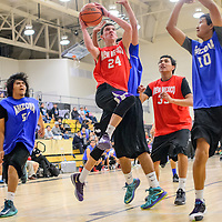 040314       Cable Hoover<br /> <br /> New Mexico's Reese Foutz (24) leaps past the Arizona defense for a layup during the Arizona New Mexico Allstars match at Miyamura High School Thursday.