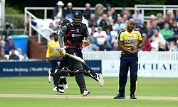 Chris Gayle of Somerset takes a run while Tino Best of Hampshire looks frustrated - Mandatory by-line: Robbie Stephenson/JMP - 19/06/2016 - CRICKET - Cooper Associates County Ground - Taugnton, United Kingdom - Somerset v Hampshire - NatWest T20 Blast