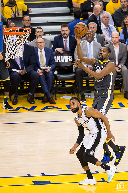Golden State Warriors forward Kevin Durant (35) takes the ball to the basket against the San Antonio Spurs during Game 2 of the Western Conference Quarterfinals at Oracle Arena in Oakland, Calif., on April 16, 2018. (Stan Olszewski/Special to S.F. Examiner)