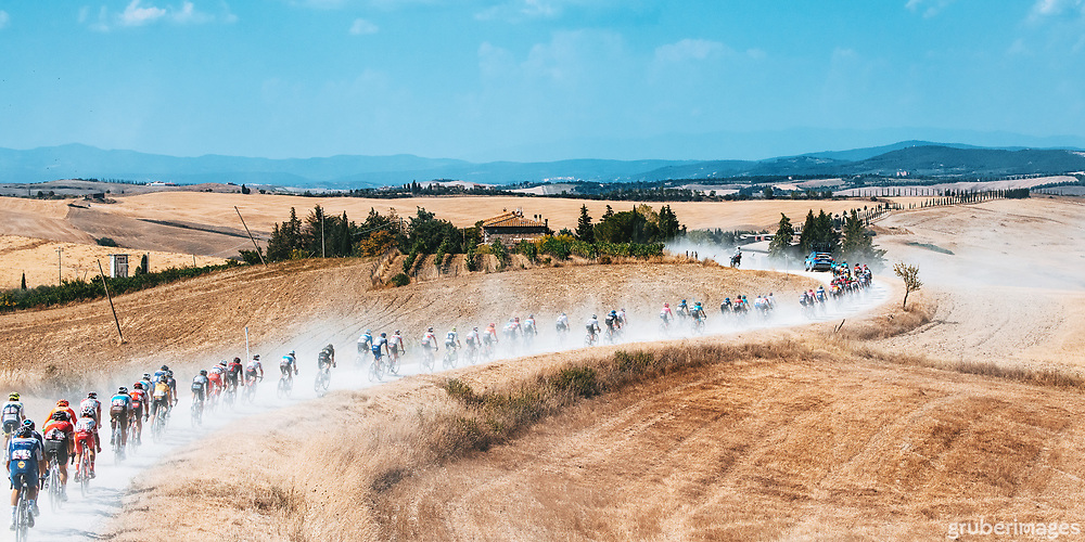 Riders in the dust at the 2020 Strade Bianche near Lucignano d'Asso.