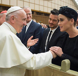 """Katy Perry releases a photo on Twitter with the following caption: """"""""Honored to be in the presence of His Holiness @Pontifex's compassionate heart and inclusivity. Thank you to @meditationbob and #TheCuraFoundation for making it all possible.❤️🕊#UniteToCure"""""""". Photo Credit: Twitter *** No USA Distribution *** For Editorial Use Only *** Not to be Published in Books or Photo Books ***  Please note: Fees charged by the agency are for the agency's services only, and do not, nor are they intended to, convey to the user any ownership of Copyright or License in the material. The agency does not claim any ownership including but not limited to Copyright or License in the attached material. By publishing this material you expressly agree to indemnify and to hold the agency and its directors, shareholders and employees harmless from any loss, claims, damages, demands, expenses (including legal fees), or any causes of action or allegation against the agency arising out of or connected in any way with publication of the material."""