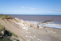 Waves crashing onto a groyne; concrete sea defences at Spurn Head; East Yorkshire; which is being eroded by the sea,