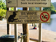 A sign of caution along the Daintree River, Daintree Village, Queensland, Australia.