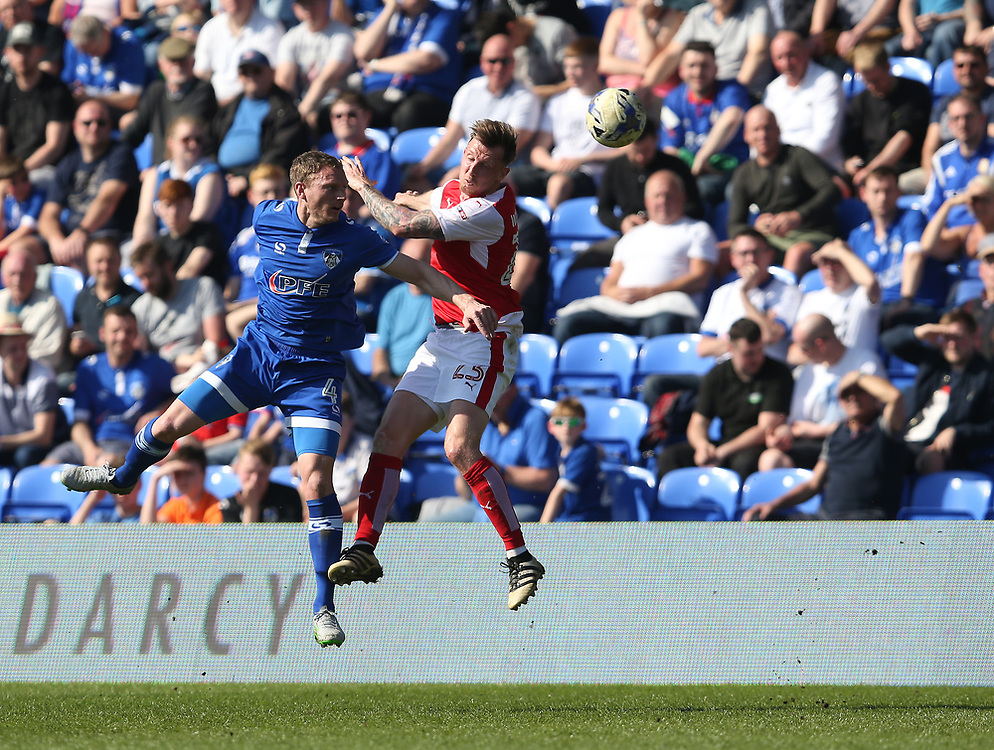 Fleetwood Town's Martyn Woolford battles with Oldham Athletic's Brian Wilson<br /> <br /> Photographer Stephen White/CameraSport<br /> <br /> The EFL Sky Bet League One - Oldham Athletic v Fleetwood Town - Saturday 8th April 2017 - SportsDirect.com Park - Oldham<br /> <br /> World Copyright © 2017 CameraSport. All rights reserved. 43 Linden Ave. Countesthorpe. Leicester. England. LE8 5PG - Tel: +44 (0) 116 277 4147 - admin@camerasport.com - www.camerasport.com