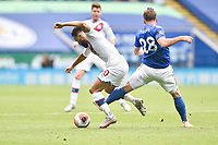 LEICESTER, ENGLAND - JULY 04: Andros Townsend of Crystal Palace evades a challenge from Christian Fuchs of Leicester City during the Premier League match between Leicester City and Crystal Palace at The King Power Stadium on July 4, 2020 in Leicester, United Kingdom. Football Stadiums around Europe remain empty due to the Coronavirus Pandemic as Government social distancing laws prohibit fans inside venues resulting in all fixtures being played behind closed doors. (Photo by MB Media)