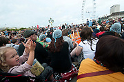 October 9th 2011. Blockade of Westminster Bridge organised by UK Uncut before the NHS bill goes before Parliament on October 12th. The crowd sit on the road and discuss what to do next.