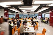 Employees take their lunch in a canteen at JD.coms headquarters in Beijing, China, on Monday, Nov. 30, 2015.  JD.com is Chinas second largest online retailer and is locked in a fierce battle with rival Alibaba.