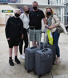 © Licensed to London News Pictures. 08/06/2021.Doncaster, UK. Paul Rodgers , Ceri Rodgers , Olivia Rodgers 16 and Jake Rodgers 12 from Leeds, arrived at 3am from Faro at Doncaster Sheffield airport ahead of the 4am implementation of quarantine rules. From 4am on Tuesday 8 June, Portugal will be removed from the Green list and added to the Amber list. Photo credit: Ioannis Alexopoulos/LNP