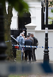 © licensed to London News Pictures.  23/07/2011. London, UK. Police and forensics outside the home of singer Amy Winehouse in Camden, North London today (23/07/2011) where the body of the singer was discovered this afternoon. Photo credit Ben Cawthra/LNP