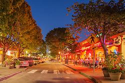 United States, Washington, Kirkland, street with shops and restaurants, lit at dusk