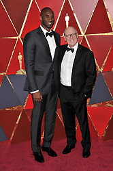 Kobe Bryant and Glen Keane walking on the red carpet during the 90th Academy Awards ceremony, presented by the Academy of Motion Picture Arts and Sciences, held at the Dolby Theatre in Hollywood, California on March 4, 2018. (Photo by Sthanlee Mirador/Sipa USA)
