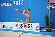 Rizatdinova Anna during qualifying at ribbon in Pesaro World Cup at Adriatic Arena on April 27, 2013. Anna was born July 16, 1993 in Simferopol, she is a Ukrainian individual rhythmic gymnast.