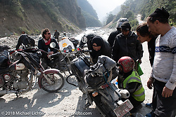 Regrouping and checking Dave Nolan's bike after a water crossing on  Day-7 of our Himalayan Heroes adventure riding from Tatopani to Pokhara, Nepal. Monday, November 12, 2018. Photography ©2018 Michael Lichter.