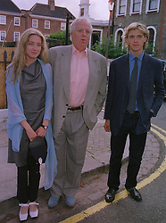 SIR TIM RICE with his children EVA RICE and DONALD RICE, at a party in London on 30th June 1999.MTY 101