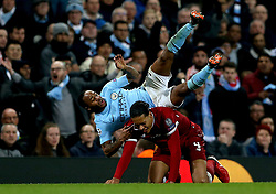 Manchester City's Raheem Sterling (top) goes over Liverpool's Virgil van Dijk during the UEFA Champions League, Quarter Final at the Etihad Stadium, Manchester.