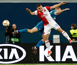 October 4, 2018 - Saint Petersburg, Russia - Aleksandr Anyukov of FC Zenit Saint Petersburg and Jan Boril (in front) of SK Slavia Prague vie for a header during the Group C match of the UEFA Europa League between FC Zenit Saint Petersburg and SK Sparta Prague at Saint Petersburg Stadium on October 4, 2018 in Saint Petersburg, Russia. (Credit Image: © Mike Kireev/NurPhoto/ZUMA Press)