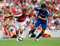 Photo: Richard Lane/Richard Lane Photography. Arsenal v Real Madrid. Emirates Cup. 03/08/2008. Arsenal's Theo Walcott is challenged by Real's Miguel Torres.