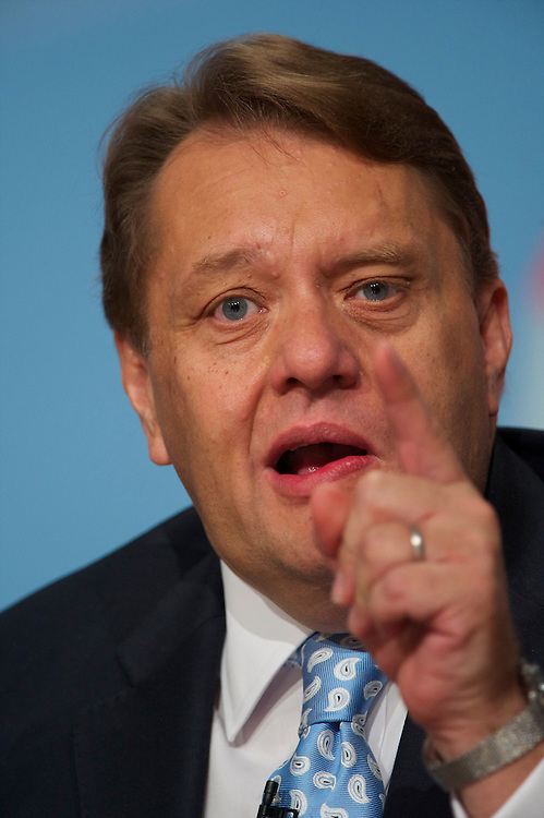 Minister of State for Business, Innovation and Skill John Hayes addresses delegates on the second day of the Conservatives Party Conference at the ICC, Birmingham, UK on October 4, 2010.  This is the first conference since the government coalition with the Liberal Democrats.
