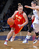 Iowa State guard Lyndsey Medders (14) drives against pressure from Kansas State's Shalee Lehning (R), during first half action at Bramlage Coliseum in Manhattan, Kansas, February 24, 2007.  Iowa State beat Kansas State 64-61.