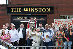 "© Licensed to London News Pictures . 28/08/2015 . Salford , UK . Mourners outside the Winston pub opposite the church after the service . The funeral of Paul Massey at St Paul's CE Church in Salford . Massey , known as Salford's "" Mr Big "" , was shot dead at his home in Salford last month . Photo credit : Joel Goodman/LNP"
