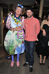 Left to right, GRAYSON PERRY and GAVIN TURK at the Contemporary Art Society's Gala evening held at the Farmiloe Buildings, St.John Street, London EC1 on 29th February 2012.