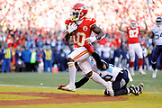 Kansas City Chiefs wide receiver Tyreek Hill (10) scores as Tennessee Titans cornerback Logan Ryan (26) defends during an NFL, AFC Championship football game Sunday, Jan. 19, 2020, in Kansas City, MO. The Chiefs won 35-24 to advance to Super Bowl 54. (AP Photo/Colin E. Braley) Colin Eric Braley Photography