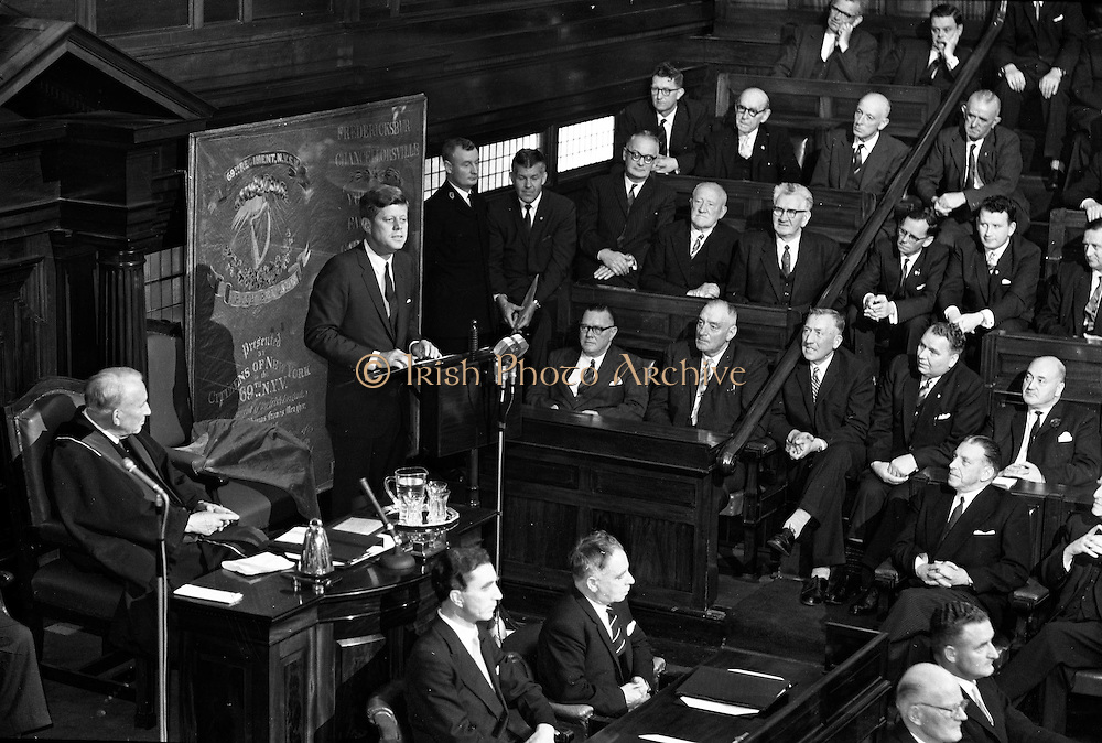 President, Kennedy, speaks, to Dail, in both Houses, 28.06.1963. U.S. President John F. Kennedy, addresses the Irish Parliament in a joint session of the Seanad, and the Dail at Leinster, House, Dublin, Ireland. The President discusses the major role played in American, history by people of Irish descent. Kennedy addresses the Houses of the Oireachtas for 26 minutes.<br /> President john F. Kennedy speak to both Dáil Éireann and of Seanad Éireann on 28th of June, 1963. Mr. John Fitzgerald Kennedy, President of the United States of America speaked  in the Dáil Éireann and of Seanad Éireann, Dublin Ireland.