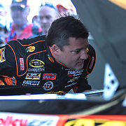 Driver Tony Stewart is seen in the garage area during the last practice session for the 57th Annual NASCAR Daytona 500 race at Daytona International Speedway on Saturday, February 21, 2015 in Daytona Beach, Florida.  (AP Photo/Alex Menendez)