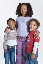 Three children smiling,