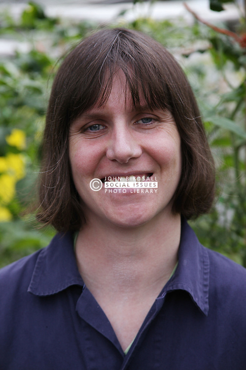 Portrait of woman with learning disability smiling; at Brook Farm; Linby,