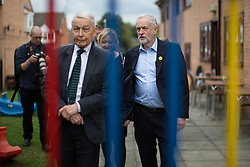 © Licensed to London News Pictures . 24/09/2016 . Liverpool , UK . JEREMY CORBYN (r) and FRANK FIELD (l) visit Beaconsfield Community House in Birkenhead , following Corbyn's victory declaration . The centre provides clothes and food that would otherwise be destined for waste from supermarkets , to local residents in need . Photo credit : Joel Goodman/LNP