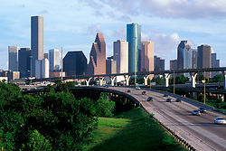 Freeway interchange near downtown Houston with the skyline in background