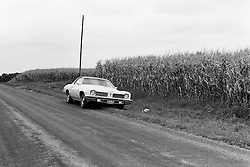 1975 - 1977 Heyworth Illinois<br /> 1974 Pontiac Lemans sits on side of a road near a cornfield.<br /> <br /> Archive slide, negative and print scans.