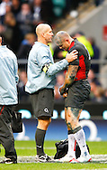Mike Tindall of England is treated by a physio during the Investec series international between England and Australia at Twickenham, London, on Saturday 13th November 2010. (Photo by Andrew Tobin/SLIK images)