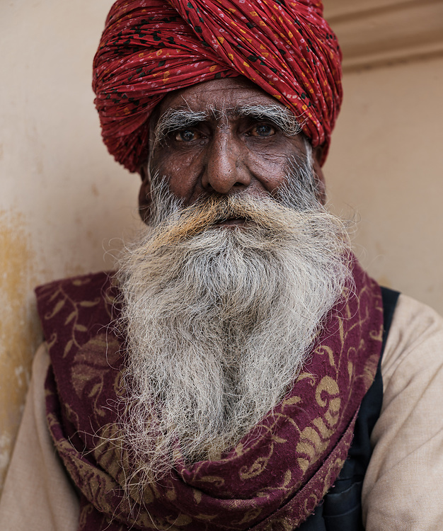JAIPUR, INDIA - CIRCA NOVEMBER 2018: Indian man with typical clothing of Rajasthan in Jaipur. Jaipur is the capital and the largest city of the Indian state of Rajasthan. Jaipur is also known as the Pink City, due to the dominant color scheme of its buildings and a popular tourist destination.