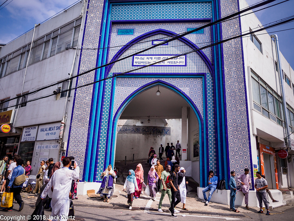 15 JUNE 2018 - SEOUL, SOUTH KOREA: People leave Seoul Central Mosque after services on Eid al Fitr, the Muslim Holy Day that marks the end of the Holy Month of Ramadan. There are fewer than 100,000 Korean Muslims, but there is a large community of Muslim immigrants in South Korea, most in Seoul. Thousands of people attend Eid services at Seoul Central Mosque, the largest mosque in South Korea.    PHOTO BY JACK KURTZ