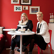 Warsaw, Poland, March 3, 2013. Paulina and Weronika Papadrowska, polish sisters, 25 and 28 years old, who founded together their own business, called 'So sweet project'. They make decorated cupcakes for parties, special events, business meeting created with an original style in decoration and shapes.