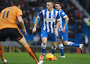 Brighton central midfielder Andrew Crofts looks for an opening during the Sky Bet Championship match between Brighton and Hove Albion and Wolverhampton Wanderers at the American Express Community Stadium, Brighton and Hove, England on 1 January 2016. Photo by Bennett Dean.