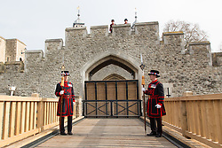 © Licensed to London News Pictures. 02/04/2014. London, UK. Yeomen Warder stand in front of a new drawbridge which is opened at the Tower of London in Tower Hill, London today, 2nd April 2014. This is the first working and rising drawbridge at the Tower of London since the 1970's. Photo credit : Vickie Flores/LNP