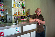 The owner of the Coney Island Bar in Victoria, the capital of the island of Gozo in Malta. The bar, opened in the 1960s is a tiny but classic Modernist cafe.