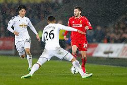 Adam Lallana of Liverpool is challenged by Kyle Naughton of Swansea City - Photo mandatory by-line: Rogan Thomson/JMP - 07966 386802 - 16/03/2015 - SPORT - FOOTBALL - Swansea, Wales — Liberty Stadium - Swansea City v Liverpool - Barclays Premier League.