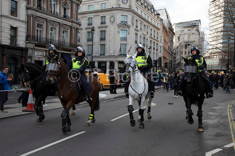 Mounted police as demonstrators gather for the 'Oppose Tommy Robinson, unite against racism & fascism' counter demonstration organised for anti-fascist groups opposed to far right politics, regardless of their positions on leave/remain on Brexit on 9th December 2018 in London, United Kingdom.