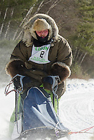Samuel LaForce of Lanoraie, Quebec leads his team (sponsors Boulia Gorrell and Busby) out onto the course during Friday's first Open Class race of the 86th annual Laconia World Championship Sled Dog Races.  (Karen Bobotas/for the Laconia Daily Sun)