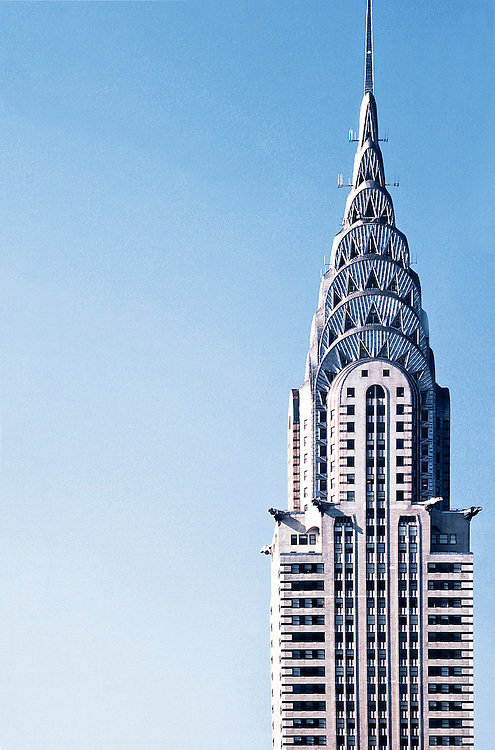 The Chrysler Building against a light blue sky