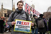Pro Brexit Leave supporter suggesting that Frexit is next as they gather in Westminster on Brexit Day as the UK prepares to leave the European Union on 31st January 2020 in London, England, United Kingdom. At 11pm on Friday 31st January 2020, The UK and N. Ireland will officially leave the EU and go into a state of negotiations as to the future arrangement and trade agreement, while adhering to EU rules until the end of 2020.