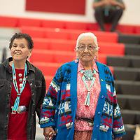 Julia Mariano, left, an elder from Mariano Lake and Dorothy Yazzie, right, from Nahodishgish, two step together during the dance. The elder fashion show was held in the Wellness Center in Crownpoint on May 07.